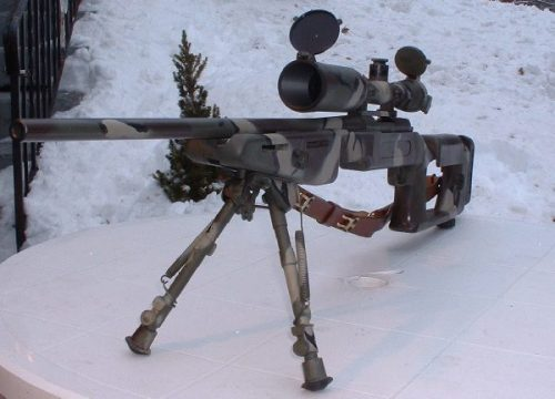 camouflaged rifle
